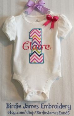 First Birthday tee shirt or bodysuit Monogrammed Chevron - Personalized free - embroidered 1st birthday creeper rainbow number with name bow by BirdieJamesEandS on Etsy https://www.etsy.com/listing/192263393/first-birthday-tee-shirt-or-bodysuit