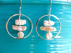 Freshwater Pearls with beautiful luster in stick and coin shapes wire wrapped with 24 gauge sterling silver wire and suspended from sterling