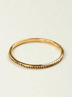 18 carat gold ring by Satomi Kawakita. Tiny black enamel holes on ring's exterior create a line of spots.