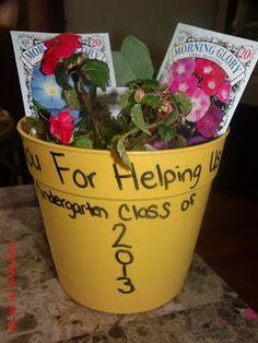 Flower pot, seeds, flower, gardening gloves.  Thank you for helping us grow