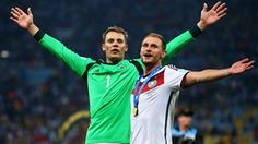 Manuel Neuer and Benedikt Hoewedes of Germany celebrate