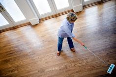 REMOVE STAINS FROM WOOD FLOORS    - Water spots: Water can cause white spots to form on a wood floor's finish. Apply a small amount of mineral spirits to an extra-fine steel wool pad and rub the spotted area in a circular motion.    - Food stains: Wipe the area with a damp cloth, then rub dry and wax.