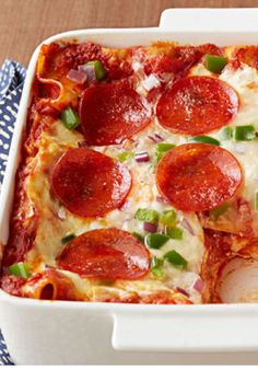 Easy Pepperoni Pizza Lasagna – Pepperoni pizza and lasagna all in one dish? That'll get your family's attention. Plus, this savory recipe is easy to make—can't beat that!