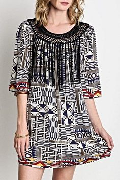 Tribal printed dress with a beaded fringe at the neck line.       Tribal Print Dress by SV. Clothing - Dresses - Short Sleeve Clothing - Dresses - Casual Clothing - Dresses - Printed Miami, Florida