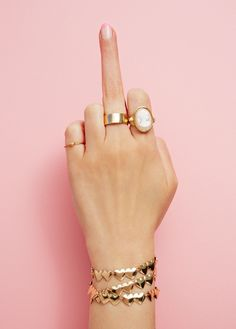 middle finger and some gold