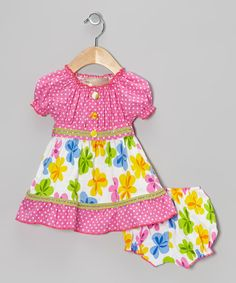 This pleasantly pretty pairing shows off a flattering combination of colors and prints on play-friendly silhouettes. The dress has a tie around the waist and each piece is equipped with elastic in all the right places.Includes dress and bloomers100% cottonMachine wash; t...