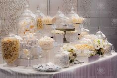 Candy favor bar - doubles as a fun and interactive feature for guests AND makes for lovely reception decor.  Can be done rather inexpensively, too!