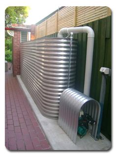 Corrugated stainless steel water tanks made to measure by Designer tanks. Discover the best and most sustainable steel water tanks on the market. Steel Water Tanks, Rainwater Harvesting System, Water From Air, Water Collection, Rain Collection System, Greenhouse Plans, Water Storage, Water Conservation, Water Systems