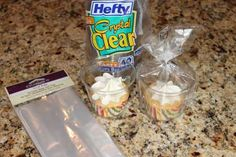 Clear cups + little bags = cupcake packaging that won't mess up the cupcake!