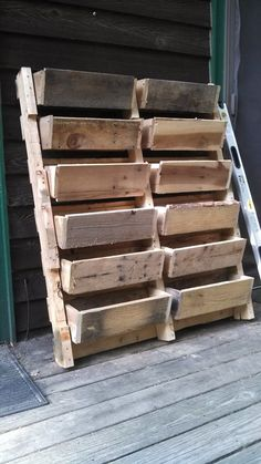 Pallet Planter Box. No instructions, but the image is great inspiration. (If you know the source of this image please leave a comment - no source found).