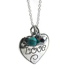 Hanging 18 inches in length, this Mama Designs necklace features a sterling silver rolo-style chain displaying a beautiful heart charm. With the word 'Love' etched on the heart and two smaller dangles