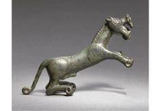 A LURISTAN BRONZE FIGURE OF A LION 9TH-7TH CENTURY B.C.