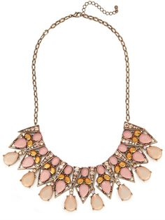 Just one word comes to mind when describing this necklace — spectacular. Just check out that extravagant chandelier silhouette, dropping with glittering gemstones of all shapes and sizes.