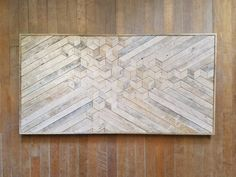 44in x 22in handmade wood wall art with reclaimed wood pattern. We can customize the size of this design in our shop if this one isnt just right for your space. Use it on a wall needing some love, a shelf or mantel, or add it to a gallery wall. This piece will add rustic texture and