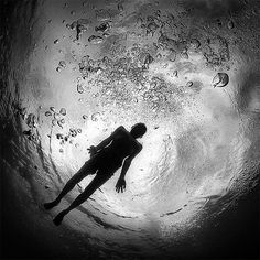 Underwater photography of scuba divers, coral, or wildlife can sometimes seem commonplace regardless of the remote destination or subject, but Indonesian photographer Hengki Koentjoro (previously here and here) bucks the trend with his desaturated, dark, and often brooding images tak