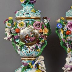 Some oversized potpourri vases  Meissen, swords underglaze blue, I choose baluster corpus with plastic launched, naturalistic staffierten flowers and fruits, to each 2 figures, pierced lid with rich floral bouquet on display and back Watteau scene, colored paint and gold painted decoration, on square Volutensockel invisible residue., in this combination and size is extremely rare, about 73 cm H, pommel swords 19th Century