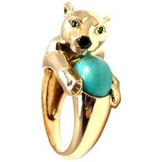 Cartier Onyx Turquoise Emerald Gold Panther Ring | From a unique collection of vintage cocktail rings at https://www.1stdibs.com/jewelry/rings/cocktail-rings/