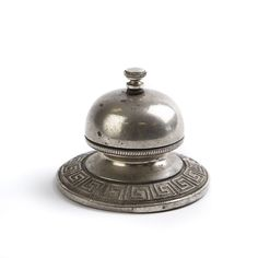 "Hotel Silver Bell  This beautiful silver bell once lived in a Paris hotel in the 1940s. In full working order, this engraved piece adds class to any home, being ringed by simply being turned instead of tapped. The piece is approximately 4"" in diameter."