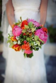 In my favorite Bouquets I've ever made!  Eclectic mix of fluffy Peonies, lime Cymbidium orchids, dainty Star of Bethlehem, and vivid Parrot tulips. Wrapped in coral silk shantung. Beautiful!  copyright KateBakerFlorals.com, 2001-2012
