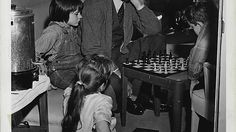 "Gregory Peck played chess with his child co-stars between filming scenes of ""To Kill a Mockingbird"", circa 1961"