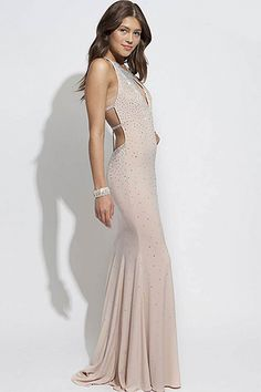 76627bee26 Blush fitted floor length gown with crystal embellishments.