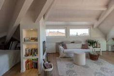 Romantica Mansarda: Soggiorno In Stile In Stile Moderno Di Bartolucci  Architetti