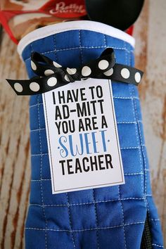 We are so excited to share some Teacher Appreciation gift ideas with all of you! We LOVE teachers around here and we love giving them some extra attention this time of year. Today, we're going to share a sweet gift for that sweet teacher. Something she can use in her kitchen. Just find a cute oven …