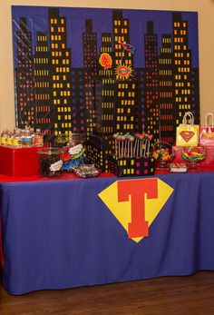 Superhero 4th Birthday Bash | CatchMyParty.com...I like the different shapes and sizes of windows on the buildings.