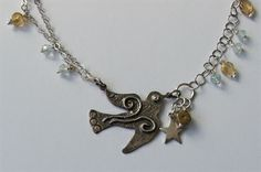 Pebbles Designer Jewellery - St Ives, Cornwall.  Bird necklace by Helen McClements