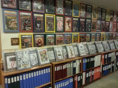 I keep my graded books framed , my artist sketches on book stands and file my reader copies alphabetically.