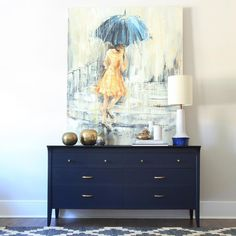 I love the soothing blues and grays, with the vibrant pop of gold.