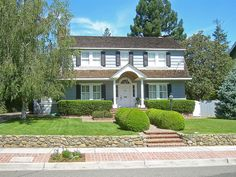 dutch colonial revival in Los Gatos, California; I really like the short retaining wall and the brick steps