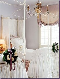 Room designed by Pamela Pierce, features lilac walls and peach roman shades.  The duvet that flows to the floor mixed with a taffeta dust ruffle.  Leaving the canopy open keeps the room airy and elegant.  Cote De Texas blog.
