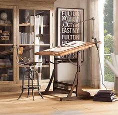 Great glassed-in bookcase.  Not really a barrister bookcase...maybe Mission style?  The drafting table brings back memories of high-school drafting classes.  The chair is practically medieval.