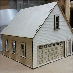 Made in the USA from Baltic birch plywood garage/workshop kit in scale. Includes 16 x 7 inch working garage door, working windows and door. Front Entry, Entry Doors, Garage Doors, Garage Kits, Two Car Garage, Dollhouse Kits, Miniature Dollhouse, Baltic Birch Plywood, Exterior Siding