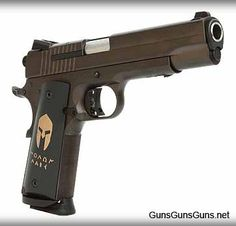 """SIG Sauer's 1911 Spartan is a full-size, 1911-style semiauto pistol chambered in .45 ACP and built on a steel frame with a steel slide. It features the famous historical phrase """"ΜΟΛΩΝ ΛΑΒΕ"""" in the same script that appears on the monument at Thermopylae in Greece in remembrance of the Battle of Thermopylae in 480 BC. The ancient Greek phrase means """"come and get them,"""" It also sports an oil-rubbed bronze nitron finish on the slide and frame, 24kt gold inlay engraving & Hogue custom Spartan…"""