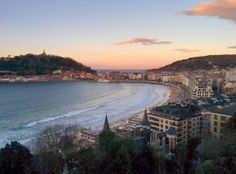 View of the sunsetting across Mount Urgull and Old Town San Sebastian from the balcony of Far Out Inn. Come see this view for yourself and book a room with us at http://faroutinn.com.