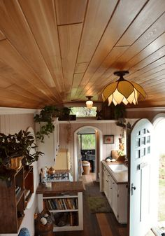 They used various reclaimed materials during construction: Douglas Fir for flooring, cedar shingles on the exterior of the bus, and wood from an old house for the paneled ceiling.