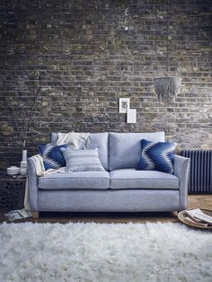 This gorgeous Carter sofa from Multiyork is perfect for snuggling up on those chilly autumn evenings. Capturing wintery hues, add warmth to this interior look with folk-inspired cushions and soft throws to complete the look.