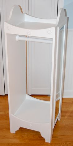 Dress up clothes organizer (plans available on etsy). DIY with side table or plant stand or long box. Add lazy susan on bottom, mirror on one side, knobs/hooks on other side. Doll Furniture, Furniture Plans, Modern Furniture, Furniture Design, Dress Up Stations, American Girl Furniture, Dress Up Storage, Doll Closet, American Girl Diy