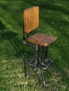 Industrial Bar Stool with Back by SawdustIndustries on Etsy. $175.00, via Etsy.