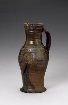 A Nottingham ware medieval pottery jug probably 14th century