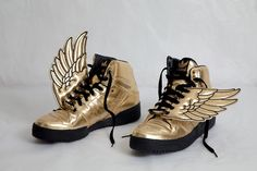 Adidas wing gold sneakers by Jeremy Scott, New York 2009.