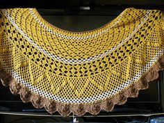 This is the ultimate gift to make for someone really special. There's just nothing like this shawl and its sister (and smaller) shawl, the Victorian Romance Shawl. It's got rows of fans, diamonds, and teardrop-like cluster stitches that form a zig zag pattern. It's a yarn eater; the border alone took a whole hank of yarn using a G/4mm hook. You won't be bored with this one!