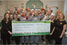 NINE 'prisoners' raised over £23,000 for Children's Hospice South West after they spent the day in the old county assizes court in Bodmin.  Betty Stogs, the Skinners' Queen of Ales, Johnny...