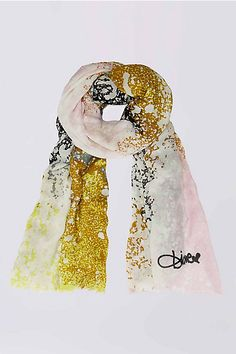 Bold and sophisticated, this soft printed scarf adds an instant pop of color to any look.