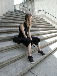 black muscle tank + black culottes + black sneakers