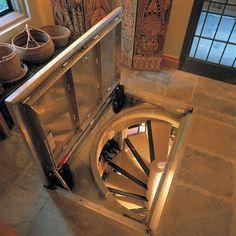 space saving wine cellar design ideas with spiral staircase Spiral Wine Cellar, Root Cellar, Underground Cellar, Home Wine Cellars, Wine Cellar Design, Trap Door, Hidden Rooms, Basement Stairs, Basement Entrance