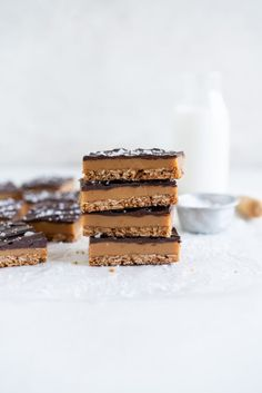 An oaty Anzac base is topped with a chewy caramel and a layer of dark chocolate for a delicious twist on a traditional caramel slice.