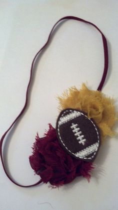 Items similar to Carlykins Boutique Baby Girl Hair Accessories Felt Football  on Burgundy and Gold Shabby Flowers on a Burgundy Skinny Elastic Headband  on ... b422a5d16b9bc